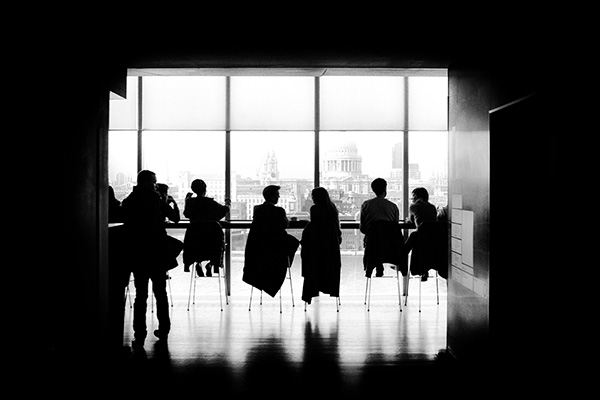 silhouettes in meeting room