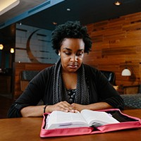 A student studies in the Mosaic Cultural Center.