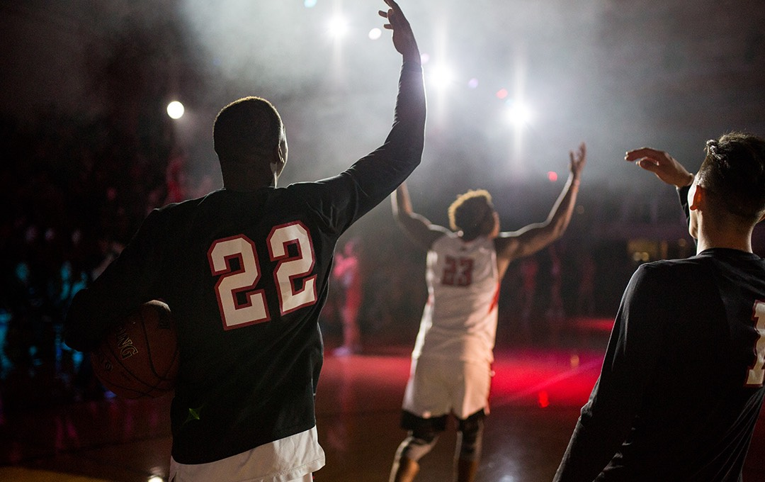 Basketball players enter the court during Midnight Madness.