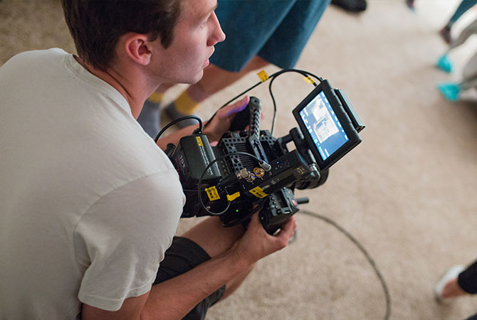 A student with a camera during a filming session