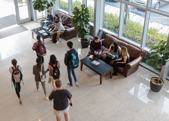 Students walking inside Crowell School of Business