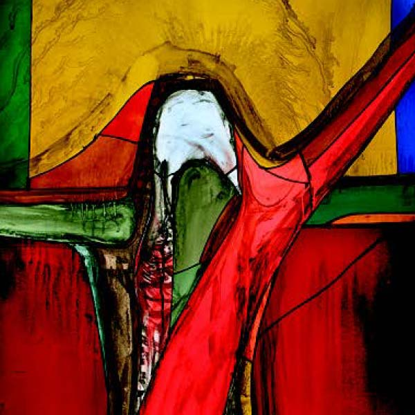 Stained glass depicting Christ with one arm raised