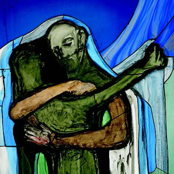 Stained glass depicting father and son embracing