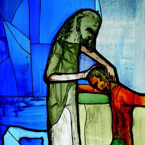 Stained glass depicting the prodigal son returning home