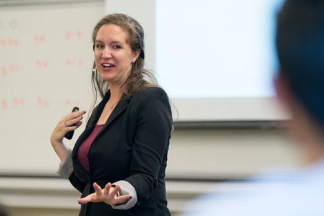 Carolyn Kim teaching in a classroom
