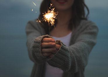 girl holding firecracker