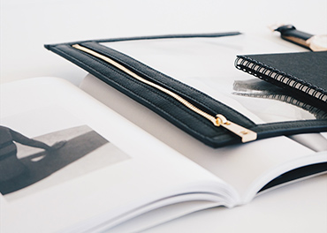 Black notebook and portfolio folder