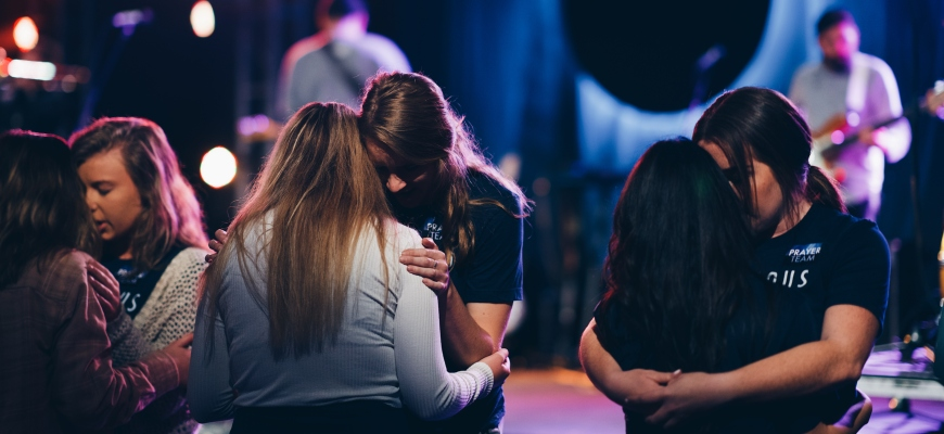 People praying together at Missions Conference