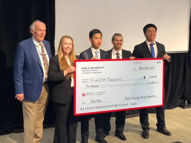 Pedal on Purpose, third place team with prize check