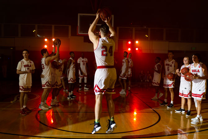 Biola Granted Full Membership in NCAA Division II Athletics, photo of Biola basketball team playing in Chase Gymnasium