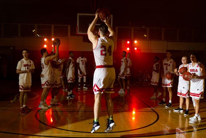 Biola Granted Full Membership in NCAA Division II Athletics, photo of Biola basketball team playing in Chase Gymnasium