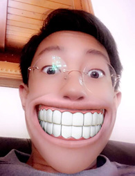 student with exaggerated smile