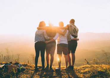 Four friends hugging