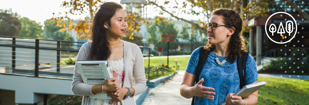 Two female students walking and talking