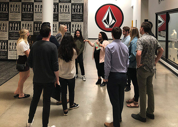 a group of students touring an office