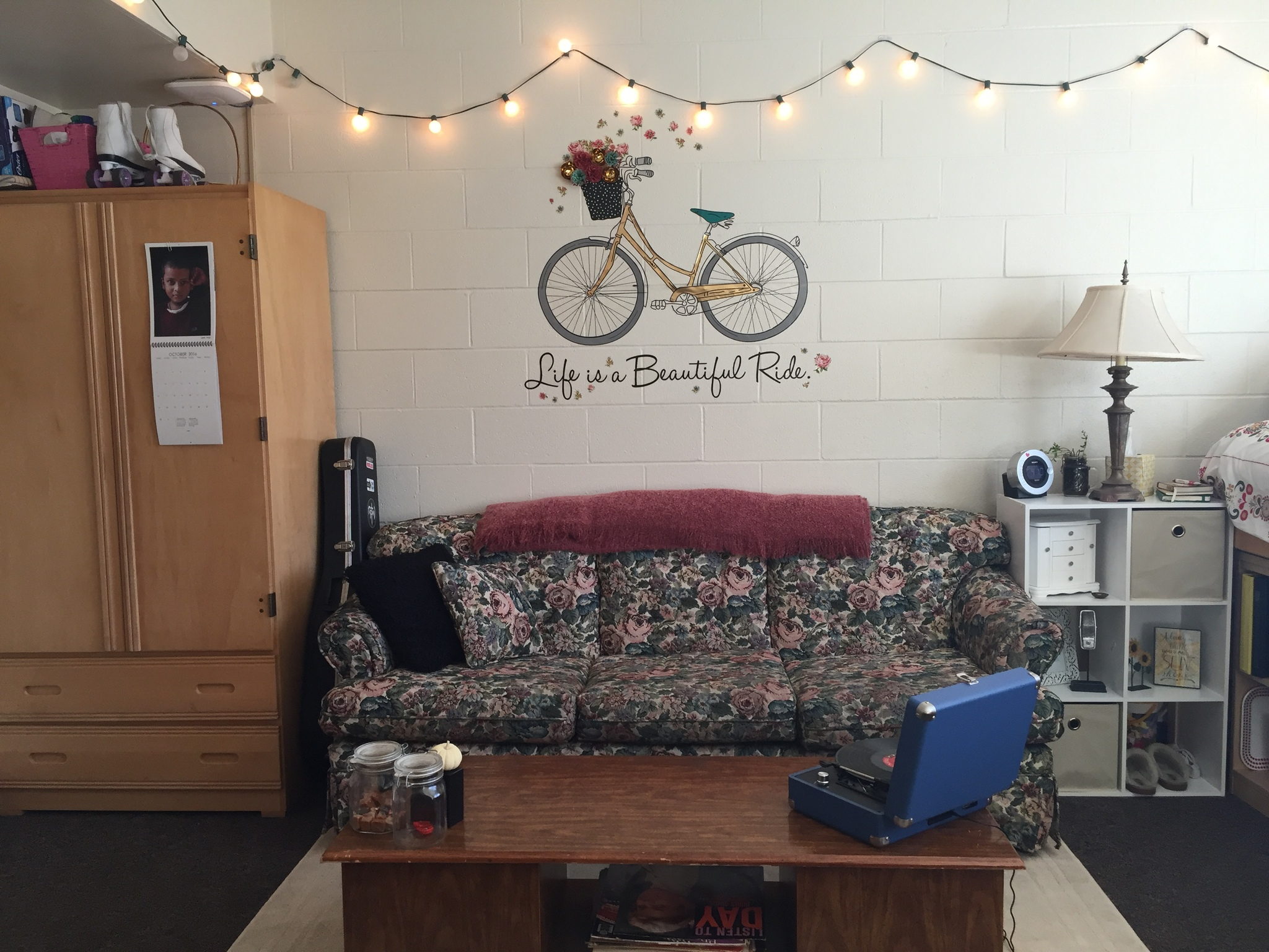 Life is a beautiful ride bicycle wall art over a vintage couch and record player