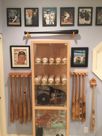 Display of baseball bats, balls and photos
