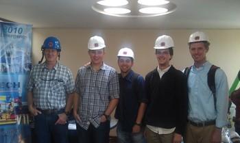 five men in hard hats