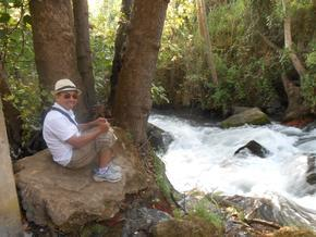 Ivan sitting near Banias Springs/River