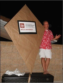 Dr. Huffman standing next to a kite