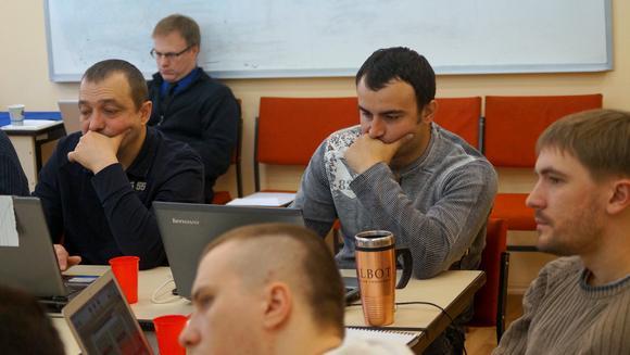 Yuriy from Mykolaev (left) and Denis from Crimea (center/right) focus on classwork despite recent upheaval in Ukraine.