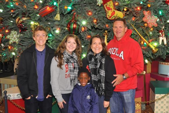 The Keehn family with Mfundo standing in front of a Christmas tree