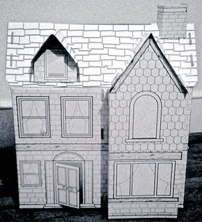 Cardboard cutout of a home
