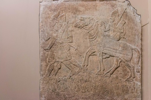 Relief of Assyrian soldiers crossing a mountain