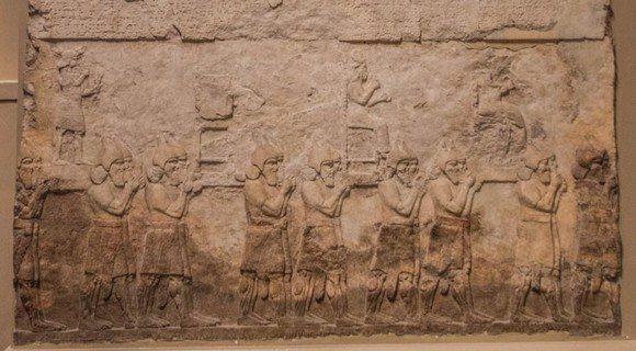 Relief of Assyrians taking the divine statues of their enemies after battle