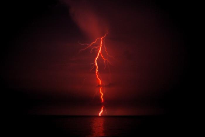 Bolt of lightning hitting the ocean