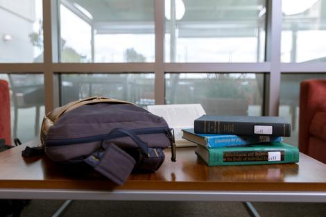 backpack and books on table