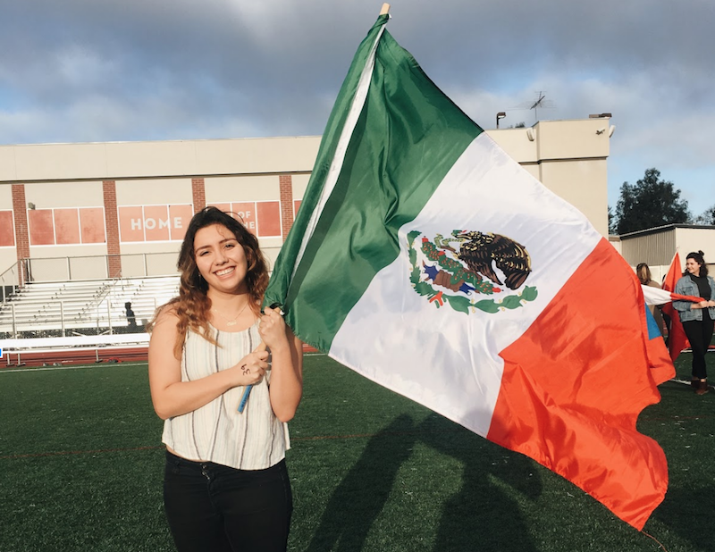 Image is of Melissa Fernanda Valle holding the Mexican Flag