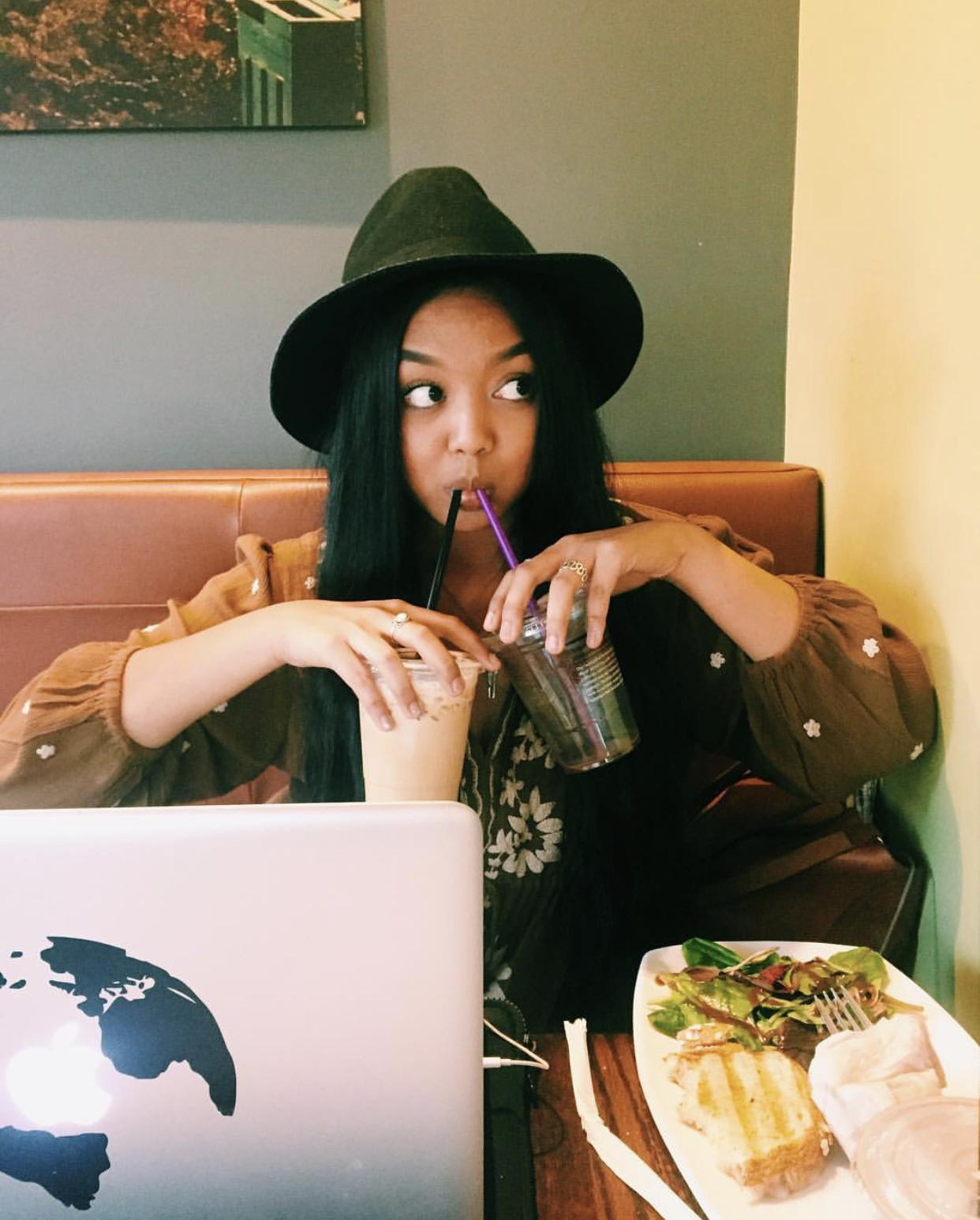 Aubrey Sipping Coffee