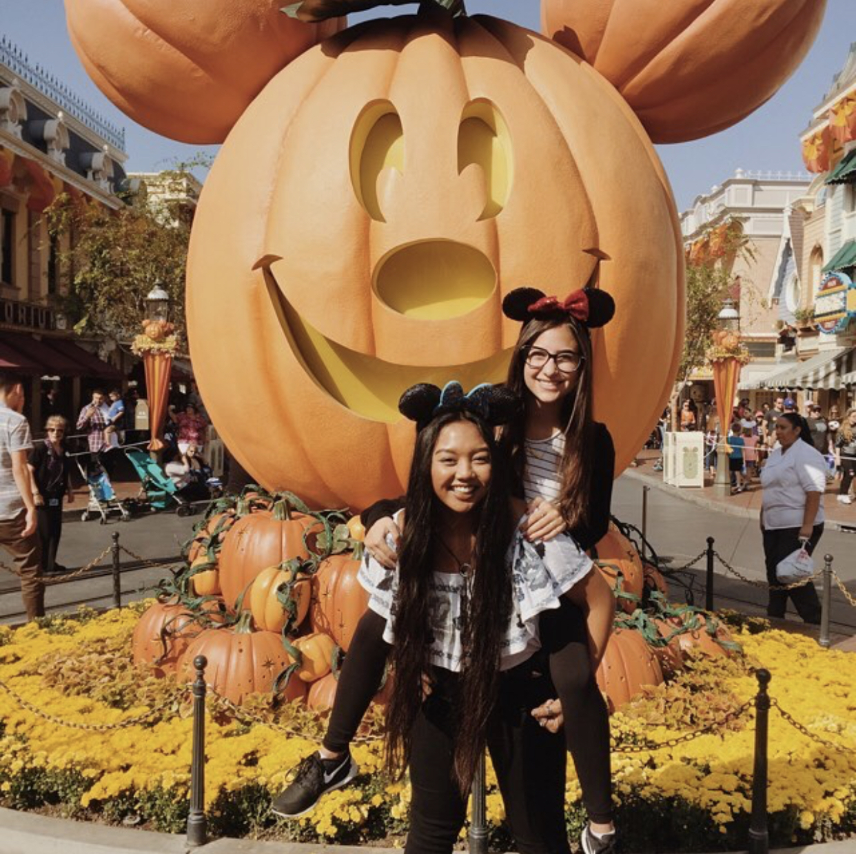 Aubrey and friend in front of Disneyland halloween Mickey Mouse
