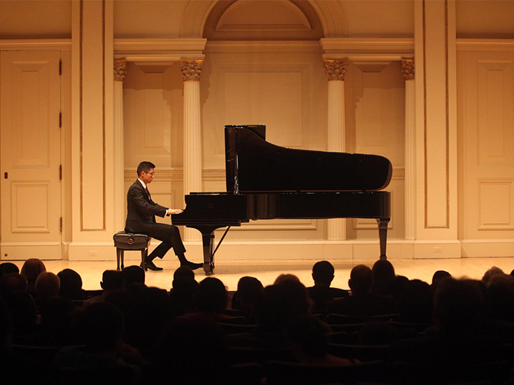 Chris Gu performs in Carnegie Hall