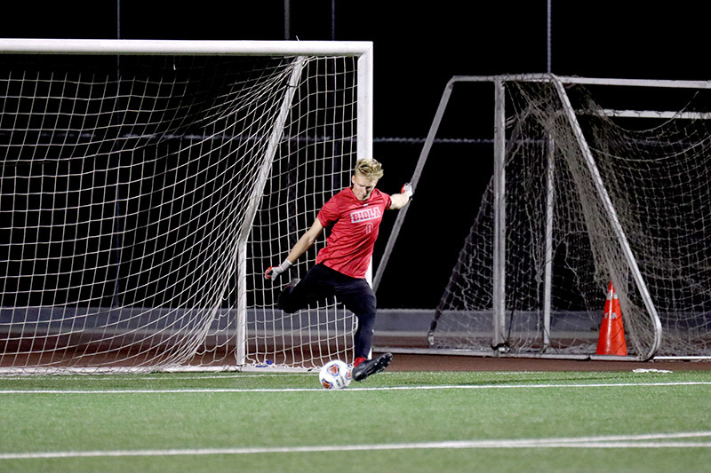 Photo of Biola soccer player about to kick the ball