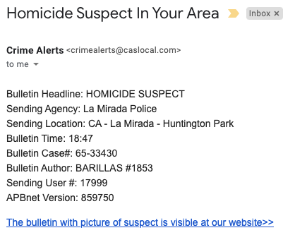 A phishing email message with the subject, Homicide Suspect In Your Area.