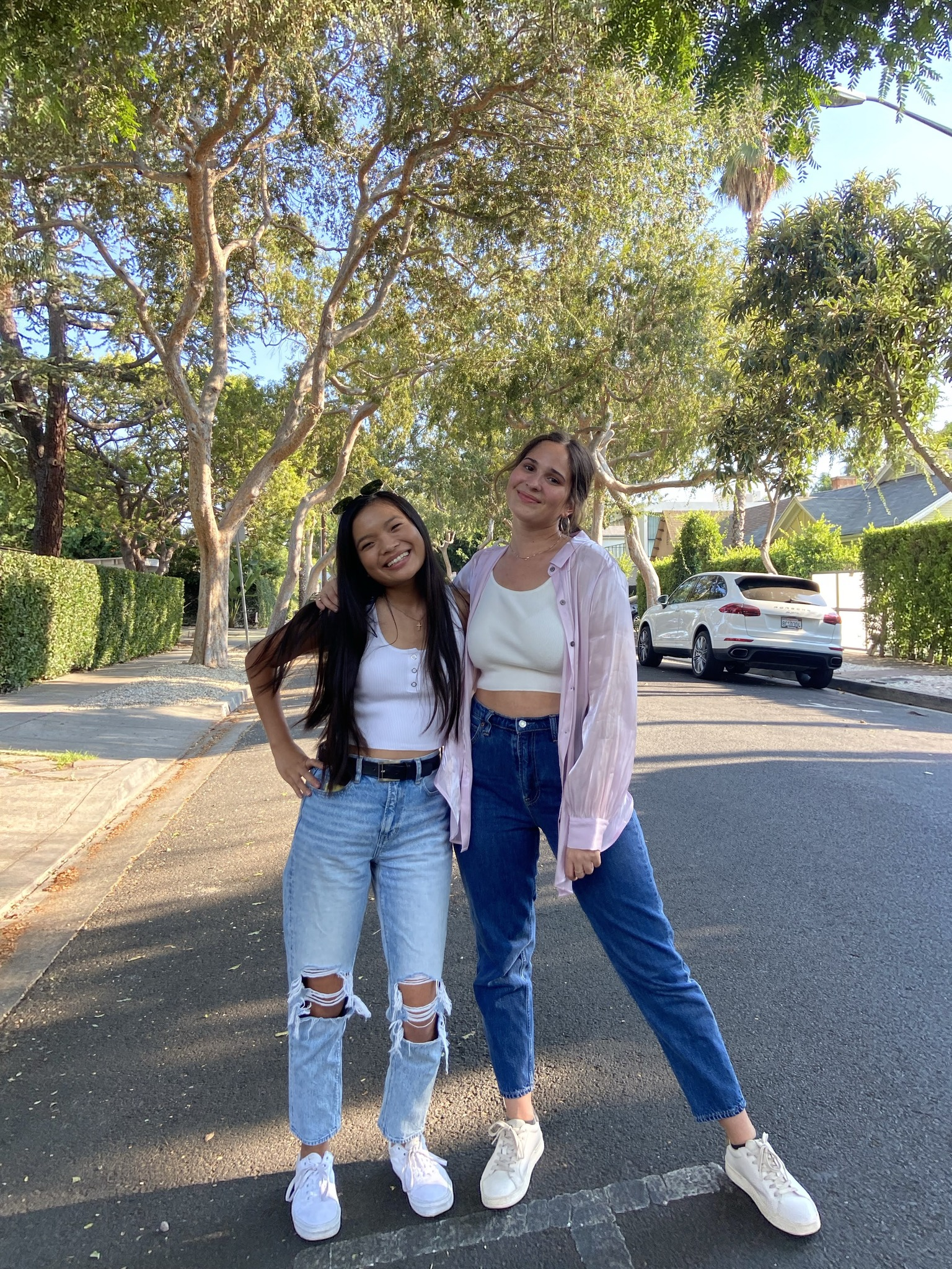 Maggie and her roommate standing in the street at La Mirada.