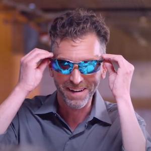 Dave, the department manager, happily tries on new sunglasses.