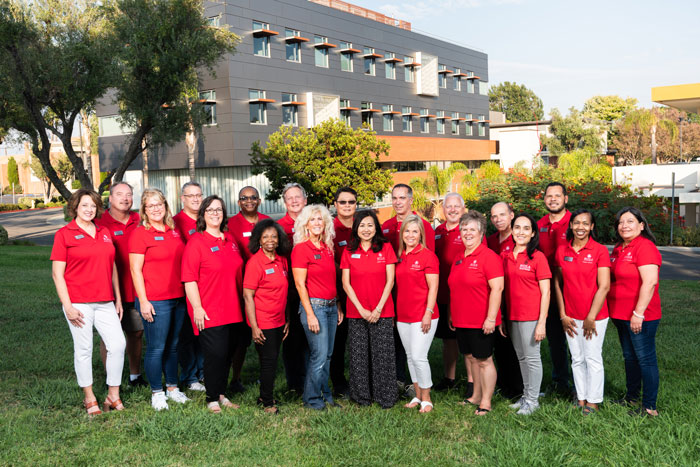 The parent council poses together in red Biola shirts
