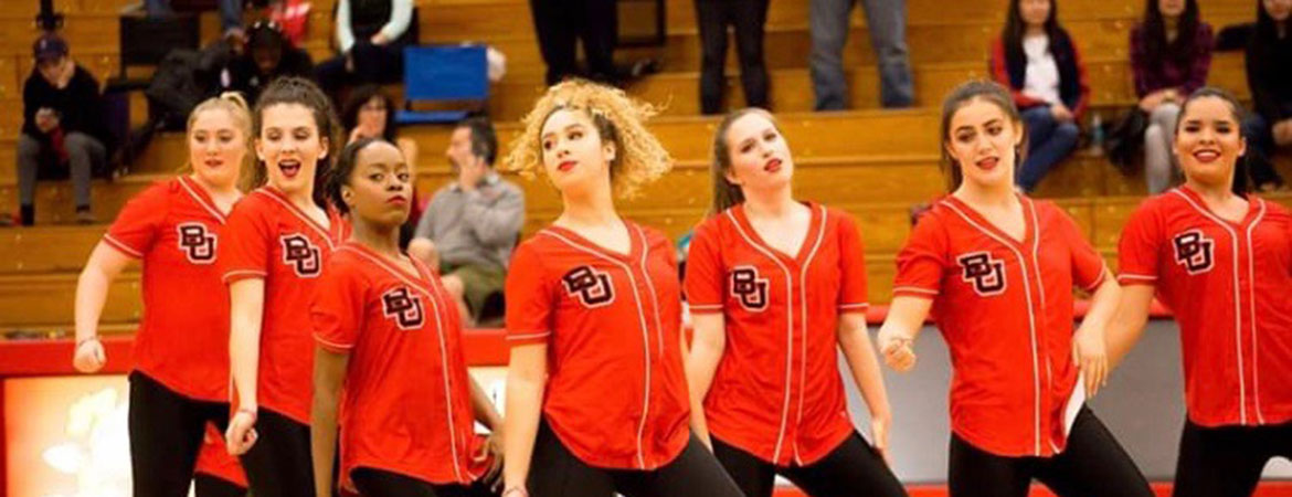 The Biola women's dance team performs in the gym
