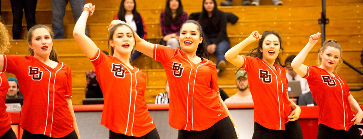 Biola's women's dance team performs together in red shirts