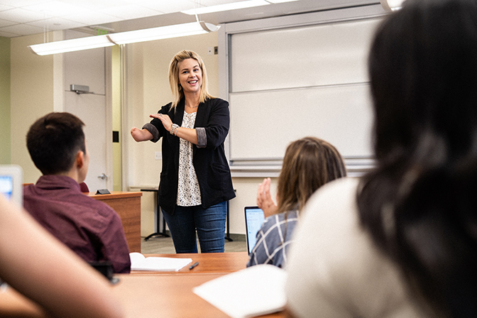 Female teaching in classroom.