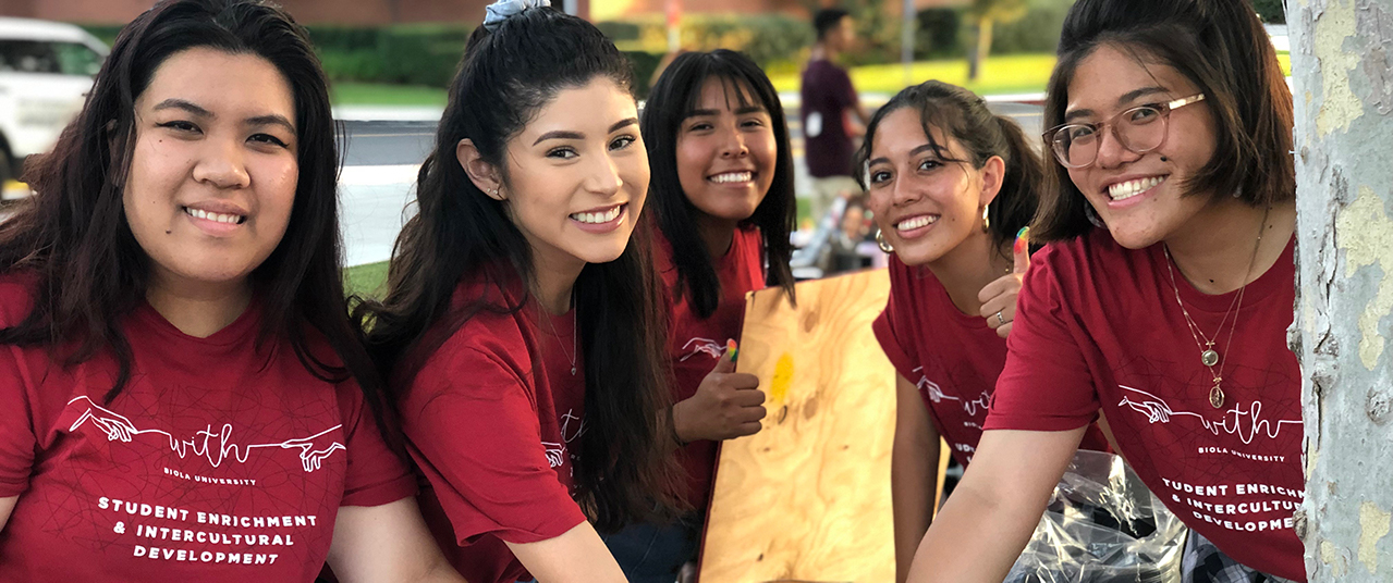 First-gen students posing at community event