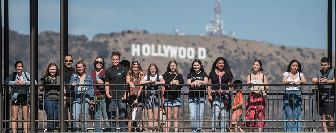Students in front of Hollywood sign